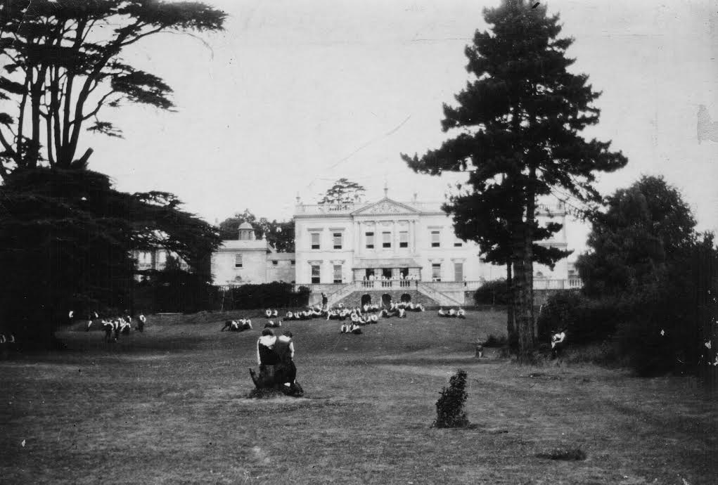 Pupils relax at recess, outside Redland Court, 1928