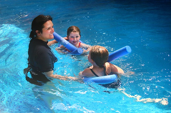 Vic Forman teaching children to swim