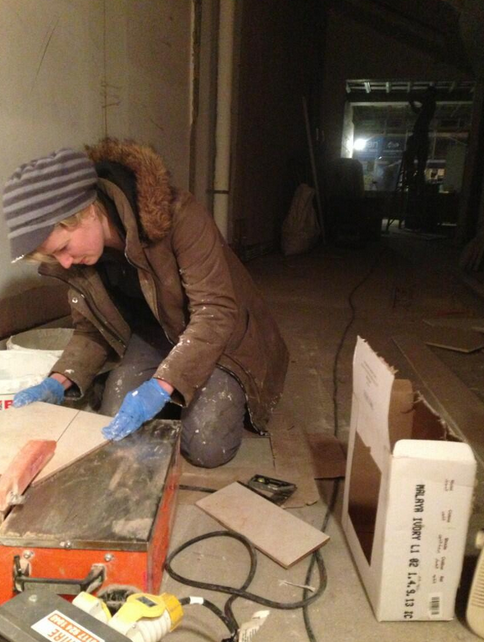 Imogen Waite, executive chef at Bakers & Co, tile cutting at the new restaurant