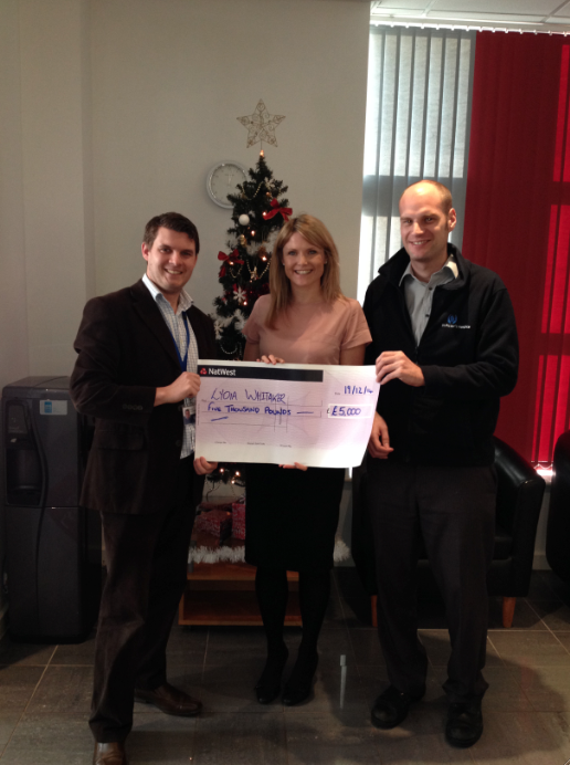 Lydia with her £5k cheque