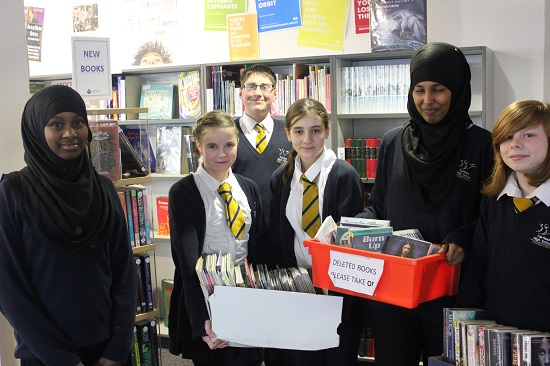Fairfield pupils with books for charity