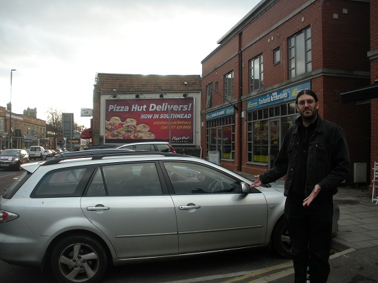 Councillor David Willingham in front of the bay outside 288 Gloucester Road
